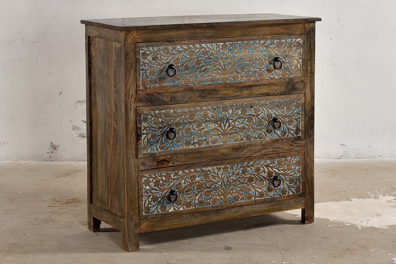 Dark wood chest of drawers with carved floral design