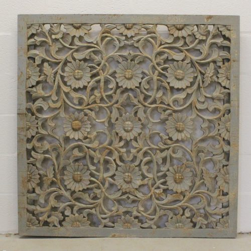 Intricately carved, floral wooden wall panel
