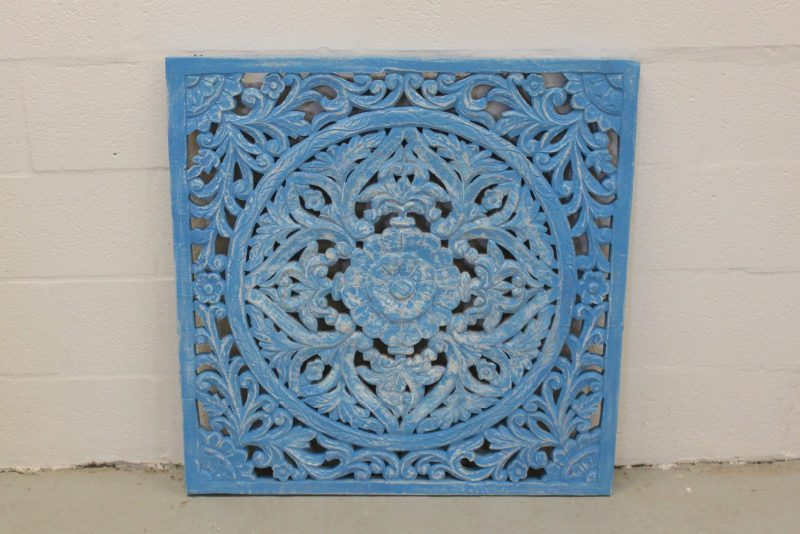 Intricately carved blue wall hanging/ art