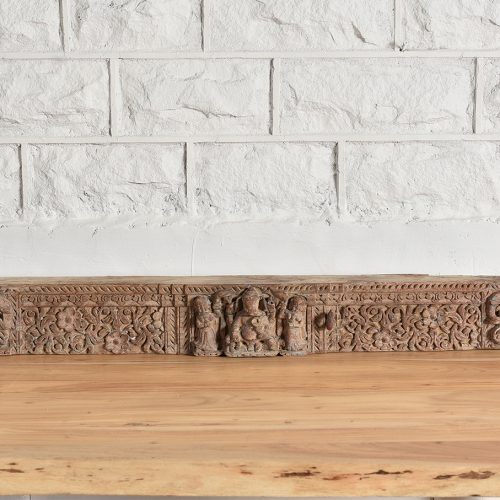 Original wooden mantel with carved Ganesh