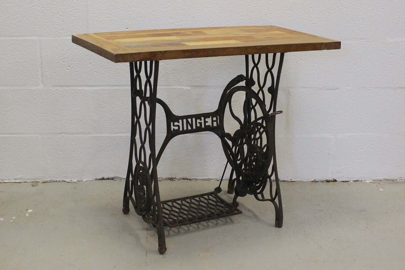 Original Singer sewing machine base with reclaimed wood top
