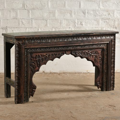 Intricately carved wooden console table