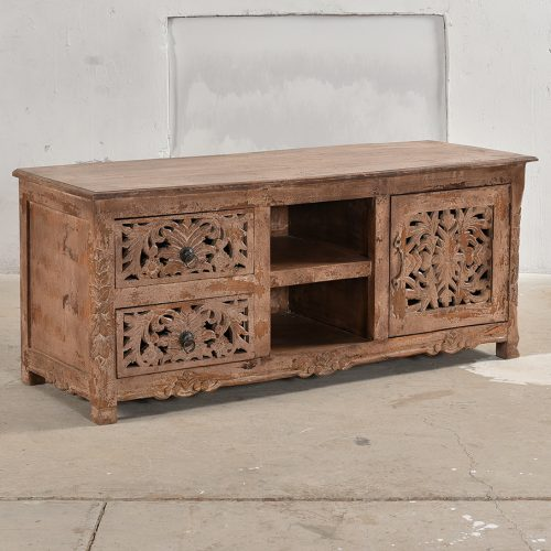 Rose coloured, carved media unit