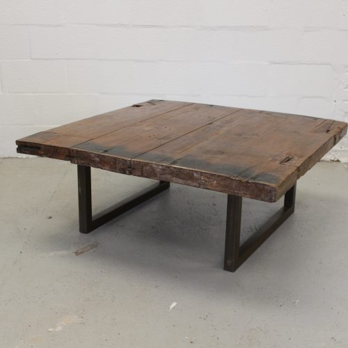 Substantial old teak wood plank table with industrial metal frame