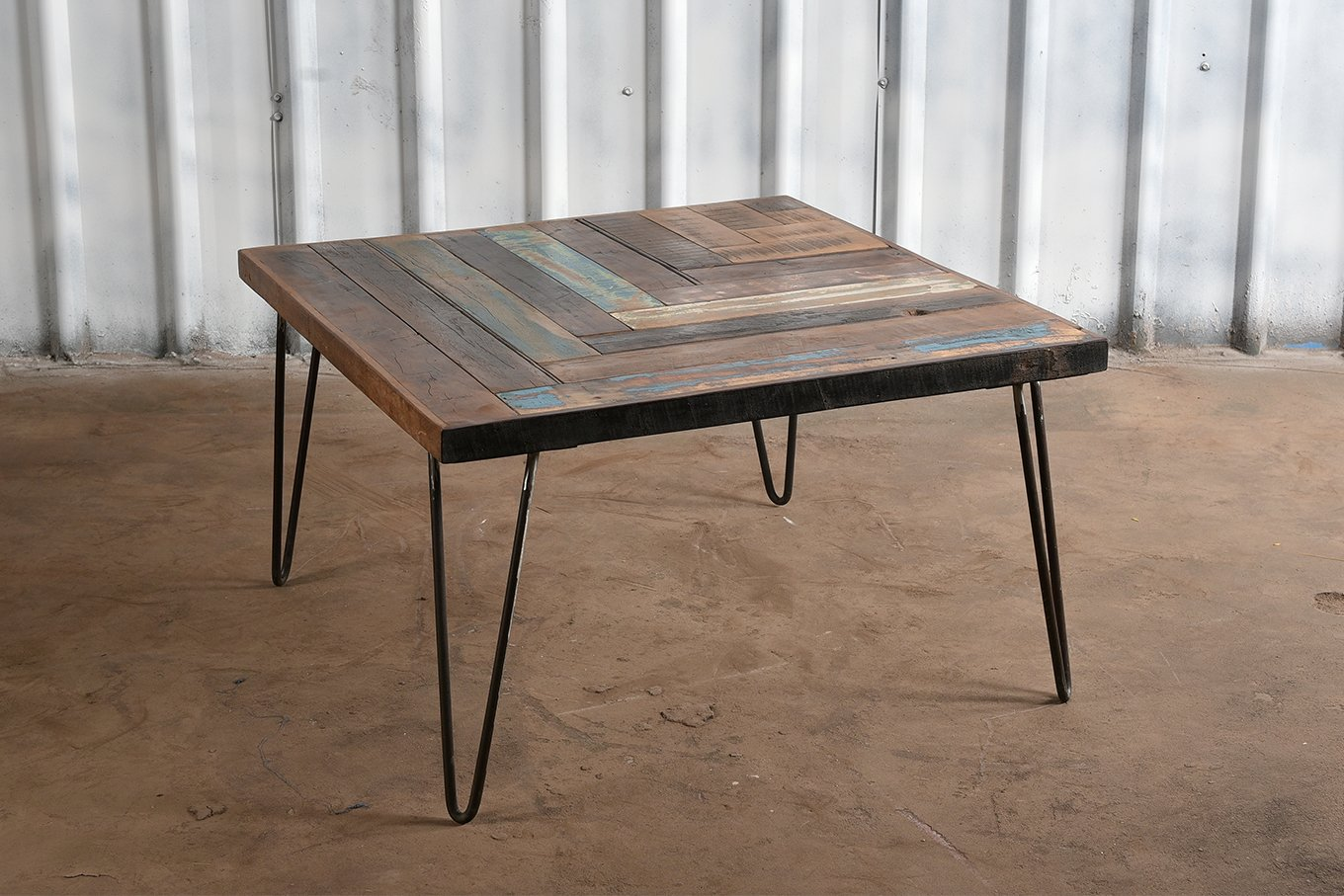 Reclaimed wooden top in chevron pattern with iron legs