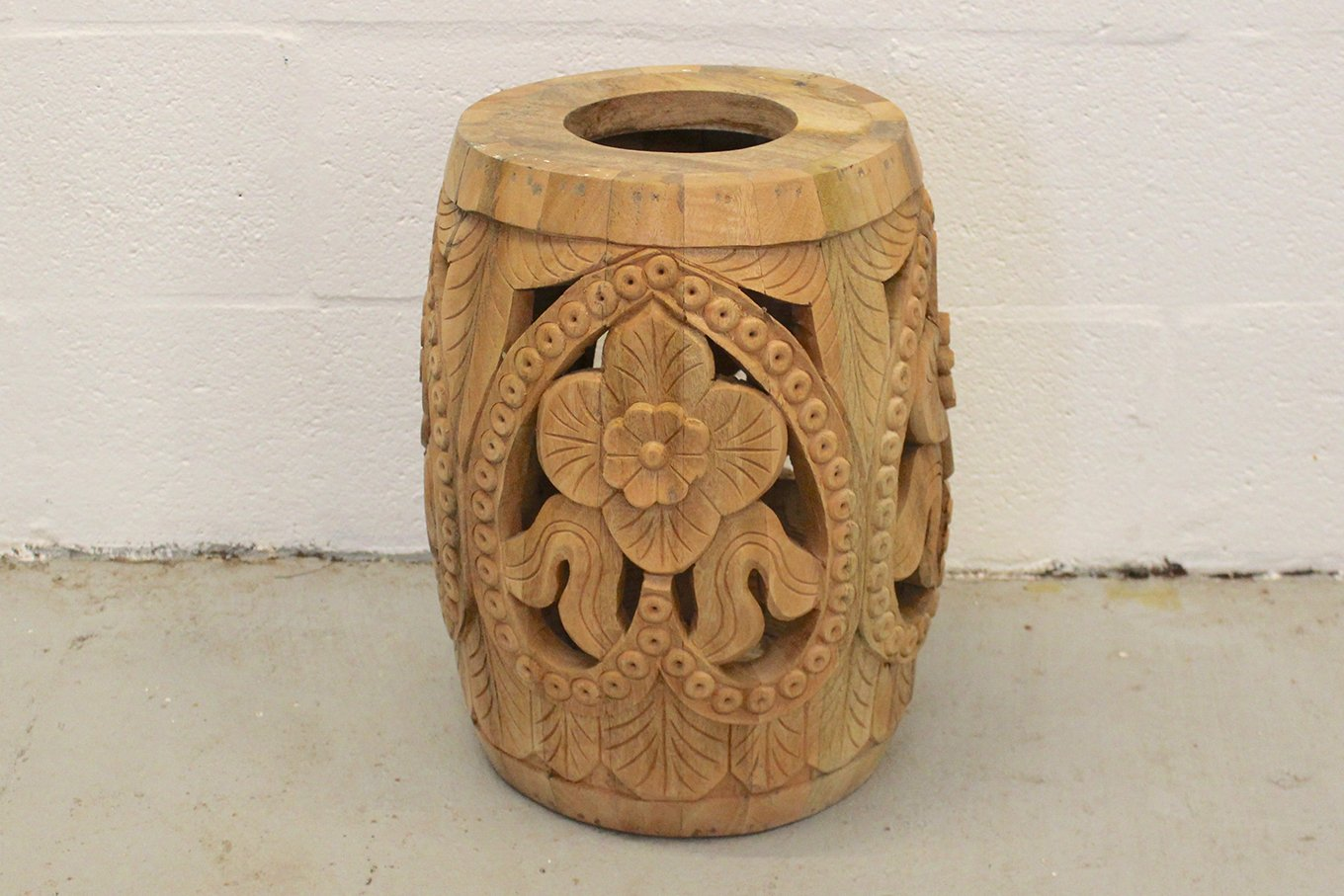 Carved wooden side table/ vase with floral theme