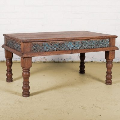 Wooden coffee table with blue carved flower surround