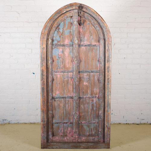 Original, faded red and blue arched door