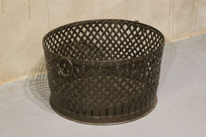 Round basket made from woven iron with handles
