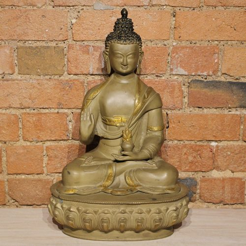 Brass Buddha seated on a pedestal with antique gold finish