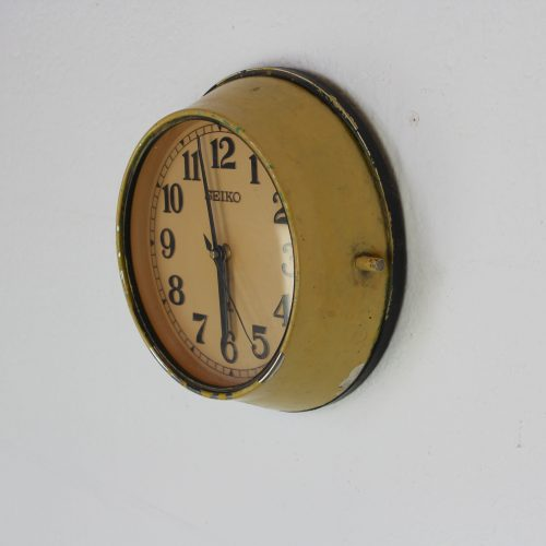 Old yellow Seiko wall clock