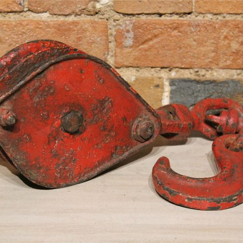 Old vintage red boat pulley