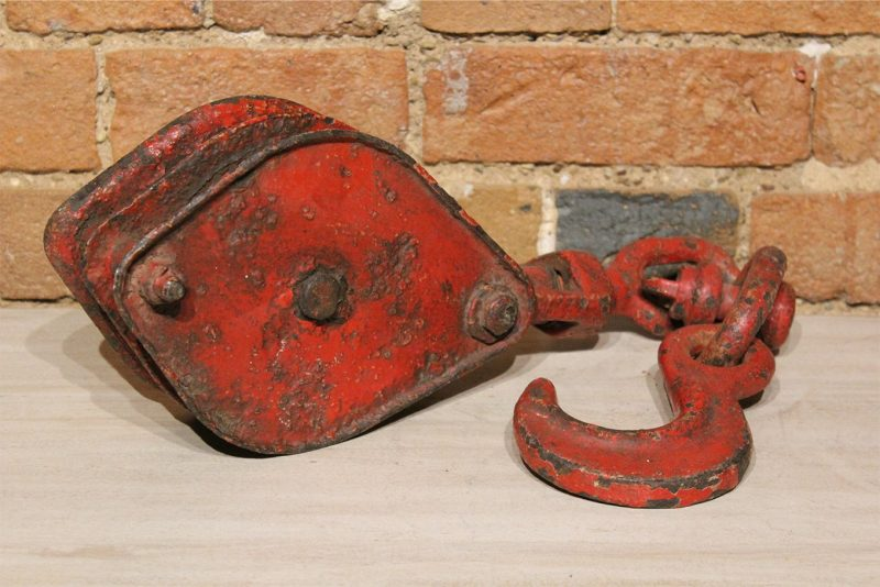 Old vintage red boat pulley