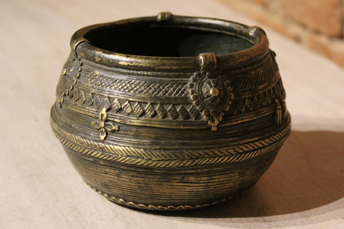 Old engraved brass pot