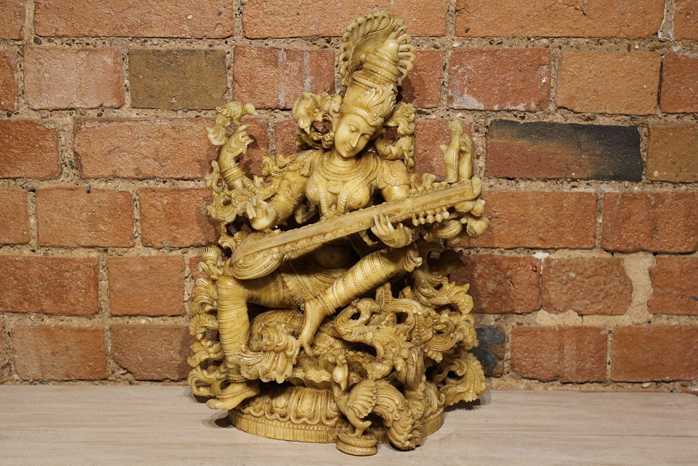 Intricately hand-carved Saraswati statue