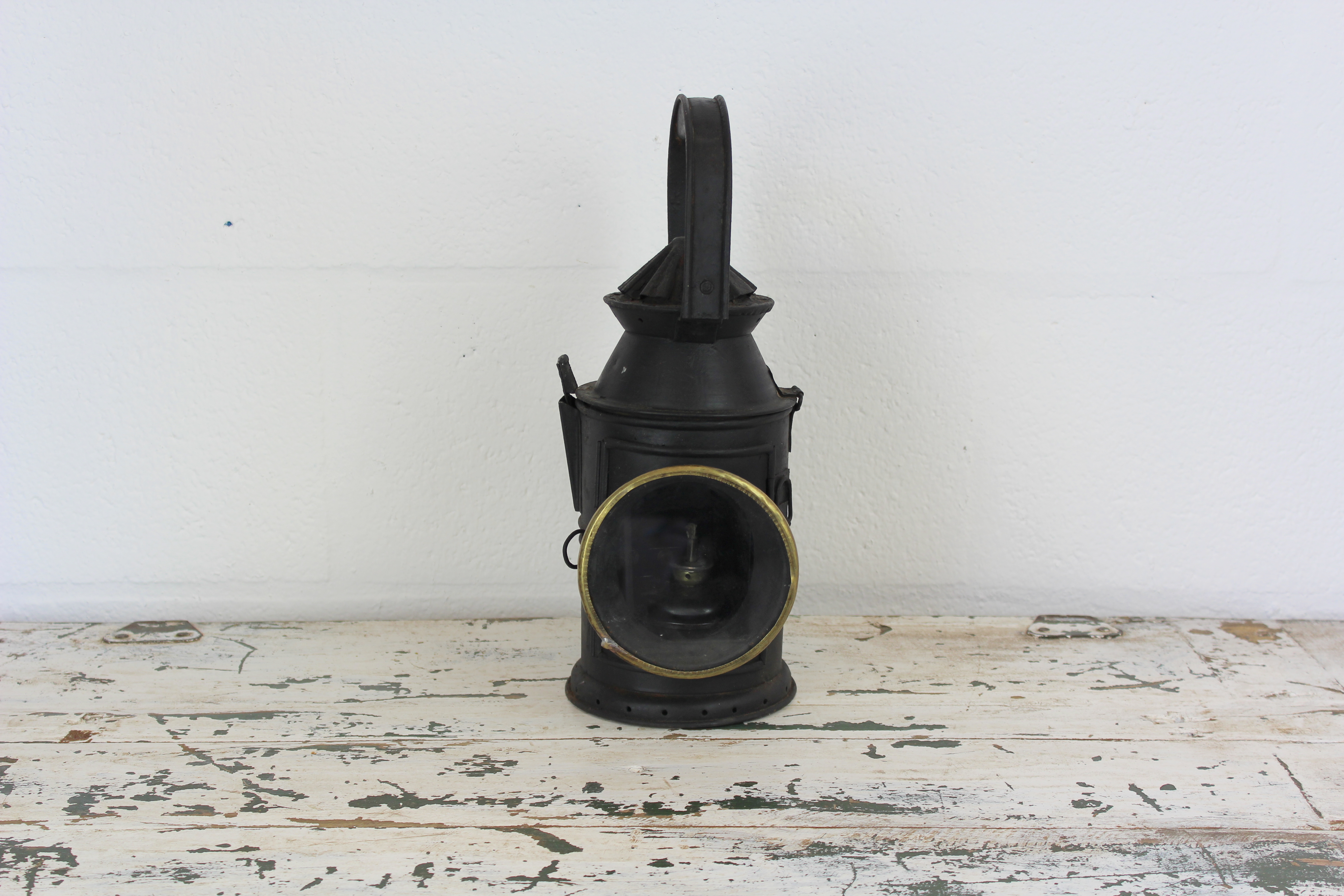 Vintage black oil lantern with brass details
