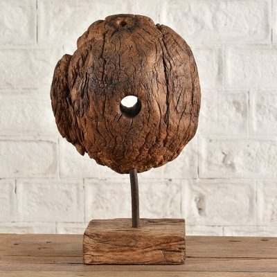 Wooden sculpture made from pulley wheel