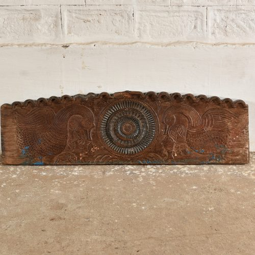 Original wooden mantel with peacock carving