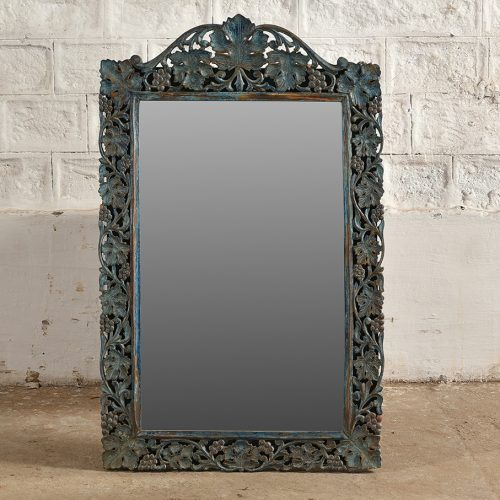 Wooden mirror with intricate blue floral carvings