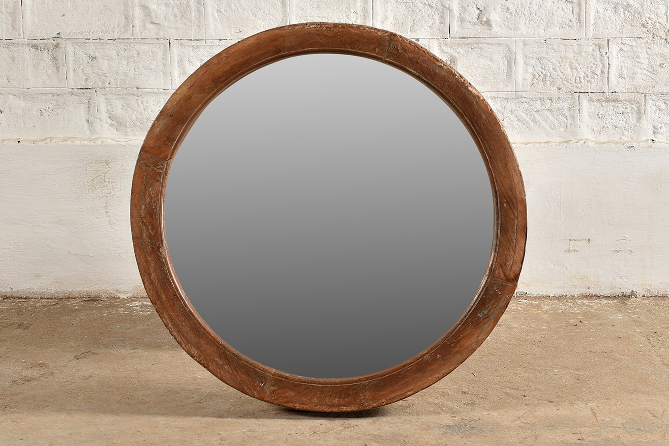 Round wooden mirror made from old wagon wheel