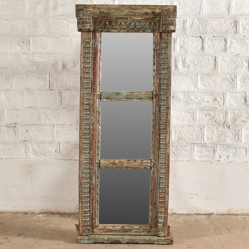 Original carved doorway repurposed as a mirror