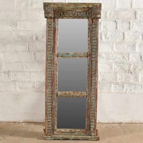Original carved doorway repurposed as a mirror