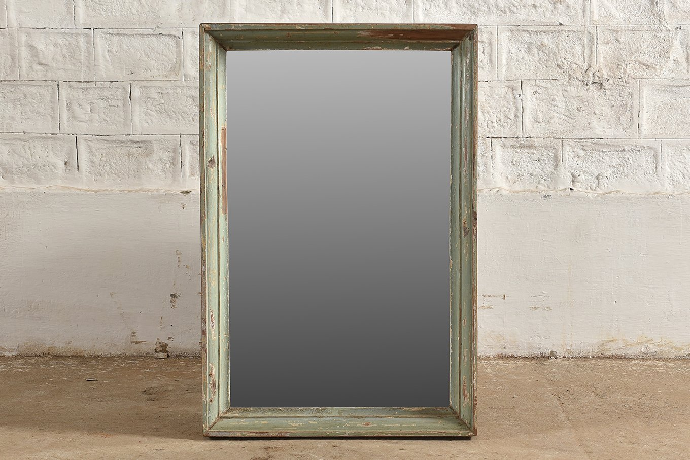 Original rectangle mirror with wooden frame and faded paint