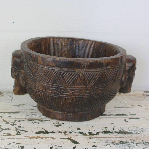 Authentic old hand carved wooden pot with engraved heads