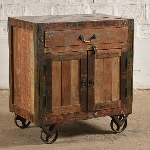 Reclaimed wooden 2-door, 1-drawer cabinet on wheels
