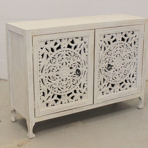 White wooden cabinet with deep carved floral pattern