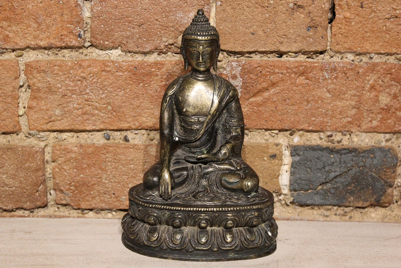 Antique bronze Buddha on lotus flower pedestal