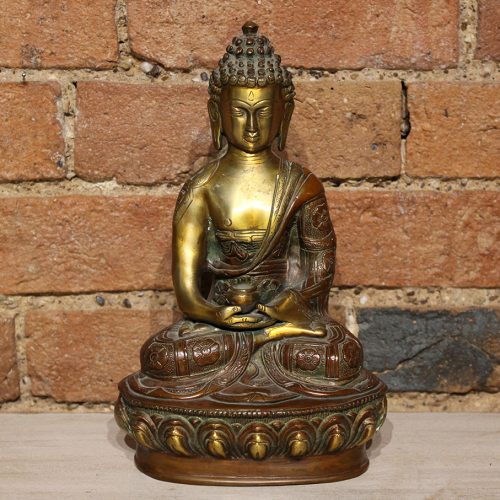 Seated gold & red brass Buddha on pedestal