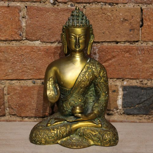 Engraved brass Buddha with green and gold detailing