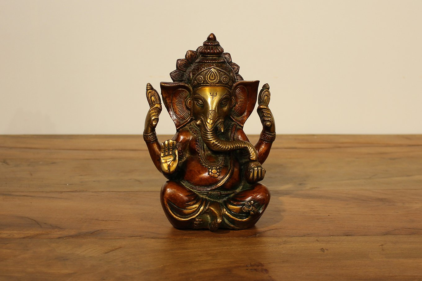 Brass statue of Ganesh in seated position