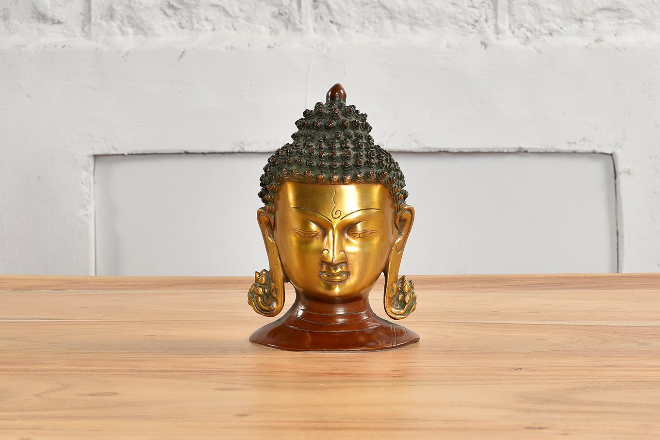 Head of Buddha in brass