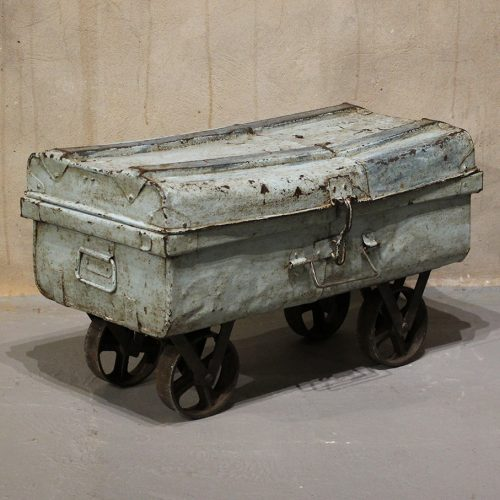 Old, light blue, metal storage trunk with wheels