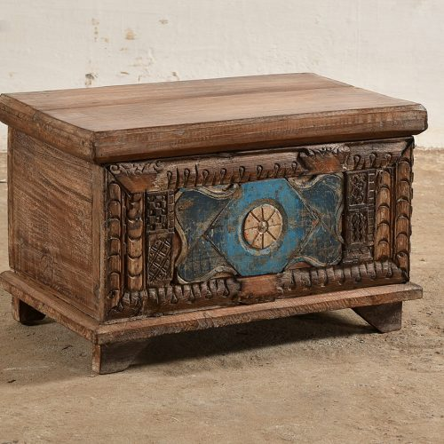Wooden storage trunk with carved front