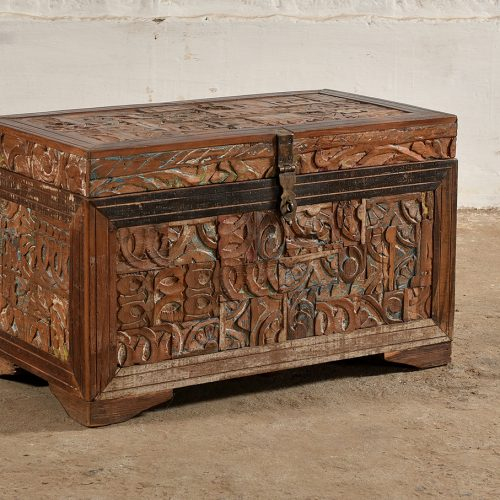 Wooden chest covered with a mosiac of carved wood