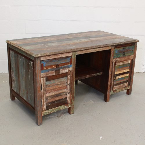 Colourful reclaimed wooden desk with shutter style doors