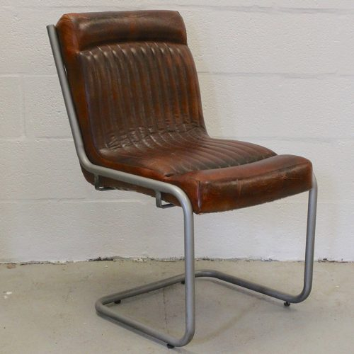 Metal framed chair with goatskin leather seat