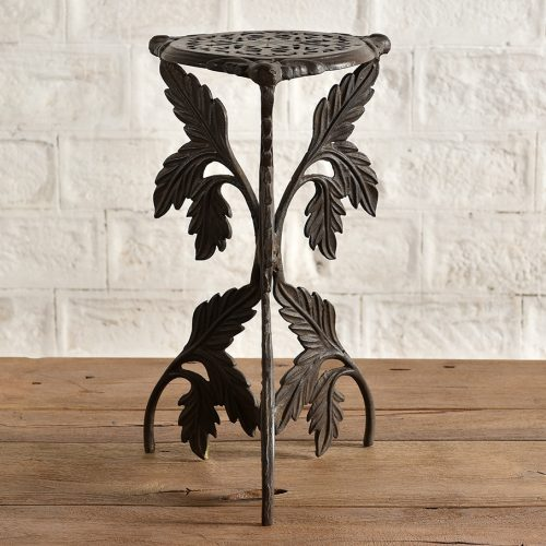 Elaborate cast iron side table