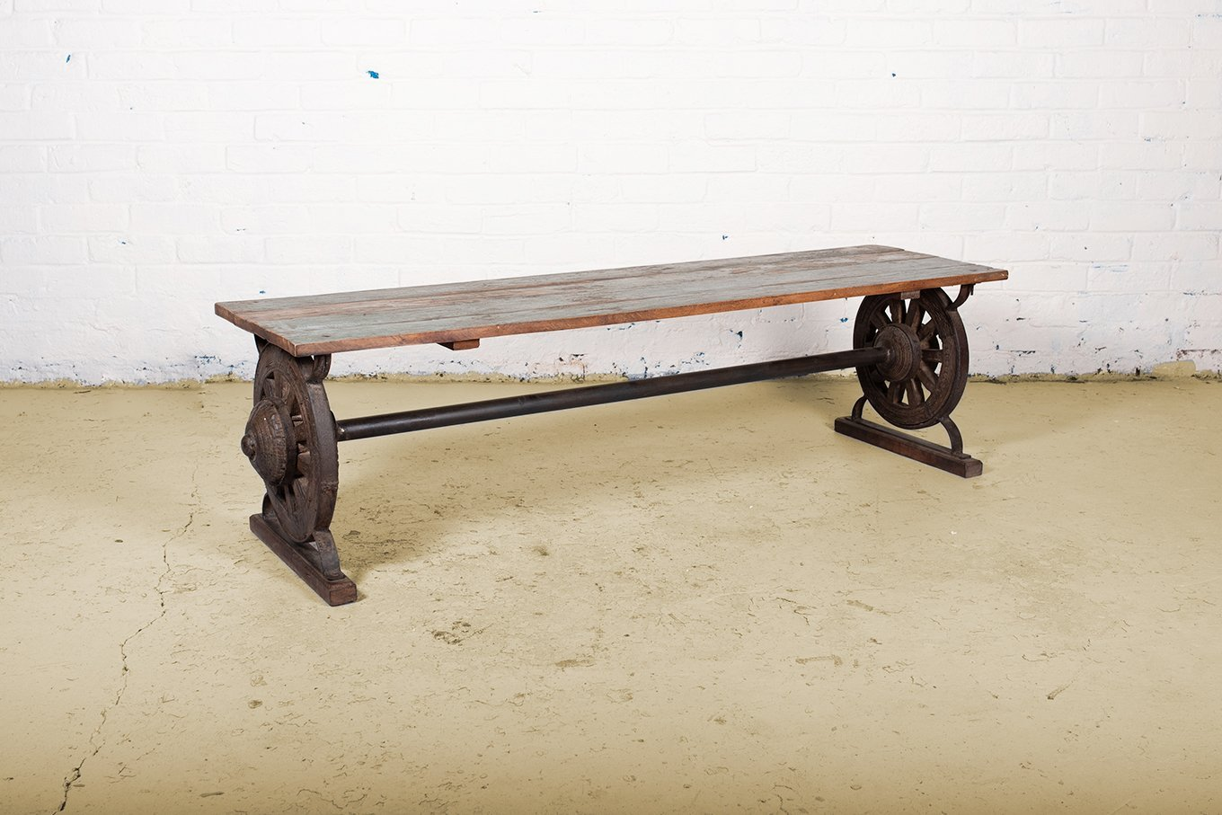 Reclaimed wooden bench made from original bull cartwheels